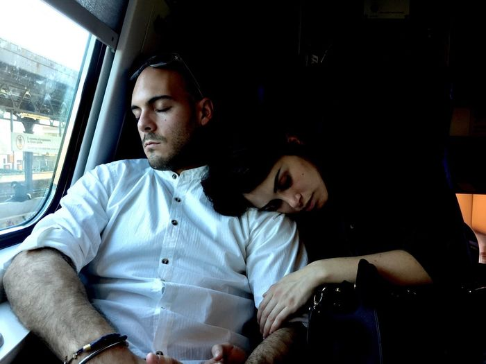 Couple Sleeping In Train