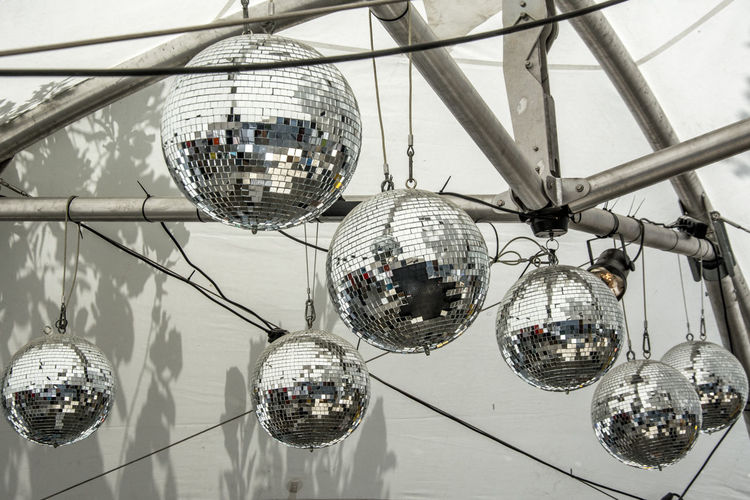 discoballs Arts Culture And Entertainment Built Structure Celebration Close-up Day Disco Ball Electricity  Hanging Illuminated Indoors  Lighting Equipment Low Angle View Nightclub No People Reflection Shiny Technology Be. Ready.