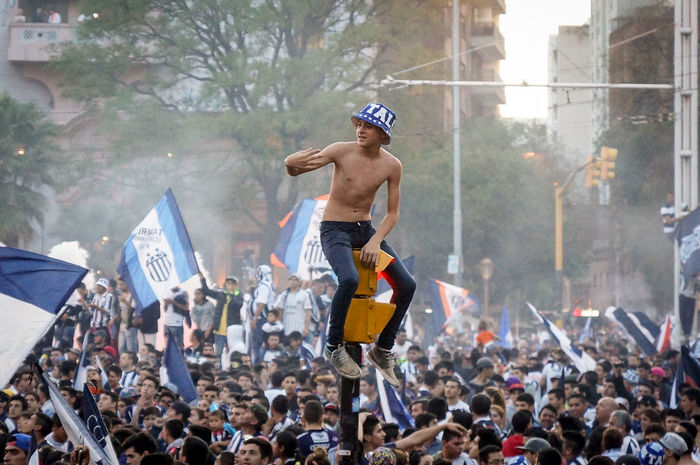 """Close up of an amateur football team """"Talleres de Córdoba"""" on a semaphore during victory celebrations in the center of the city of Cordoba, Argentina on the afternoon of October 27, 2015 Amateurphotography Celebrations Center City Close-up Football Semaphore Talleres Victory"""