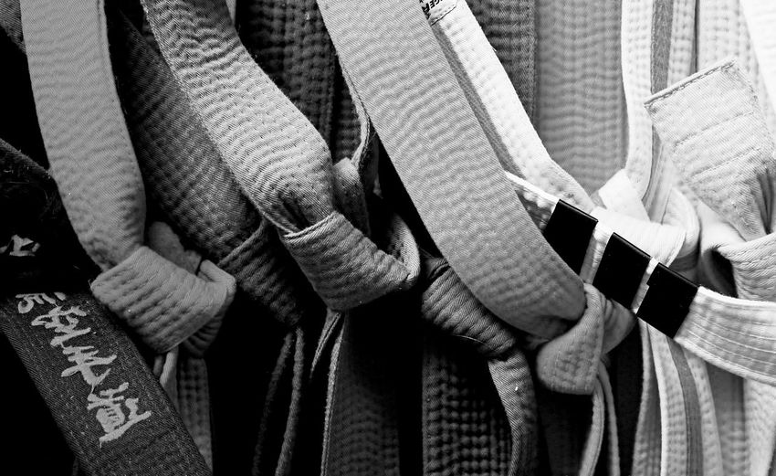 Its All About The Journey Martial Arts Path To Success Backgrounds Belts Choice Close-up Collection Full Frame Group Of Objects Hanging In A Row Indoors  Levels Of Achievement Martial Arts Belts Martial Arts Journey No People Pattern Side By Side Still Life Symbols Of Success Symbols Of Work Textile Variation