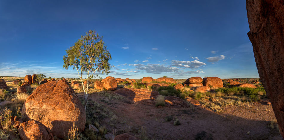 Sunset landscape at Devils Marbels, Australia Australia Beauty In Nature Devils Marbles Landscape Light And Shadow Natrue No People Outdoors Rock - Object Rock Formation Sunset Tranquility Tree