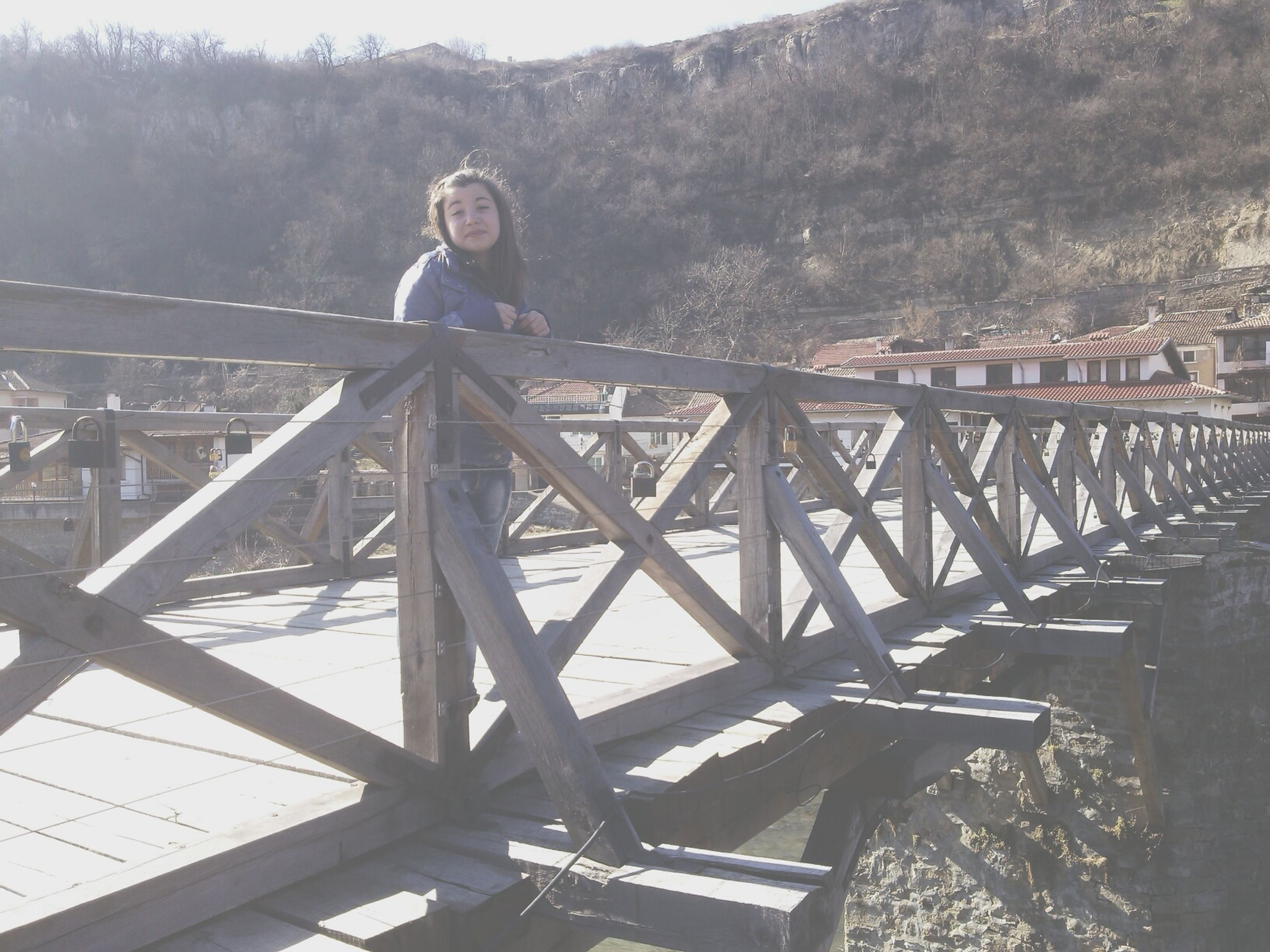 lifestyles, leisure activity, young adult, full length, casual clothing, person, railing, standing, bridge - man made structure, connection, tree, built structure, young women, portrait, looking at camera, outdoors, day