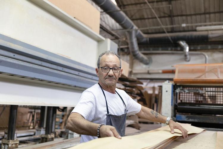 Portrait of man working in factory
