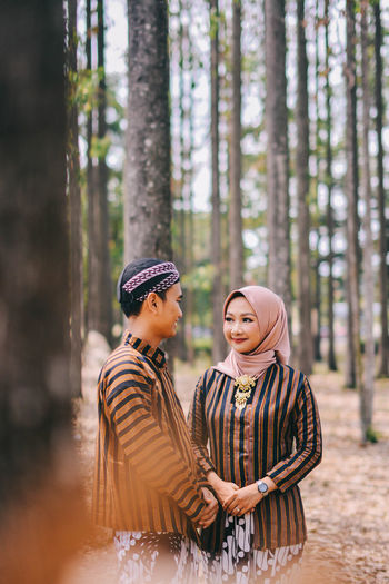 Couple kissing in the forest