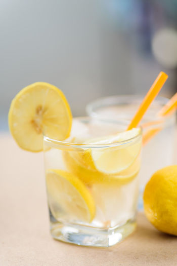 Lemonade Alcohol Blended Drink Citrus Fruit Close-up Cocktail Day Drink Drinking Glass Drinking Straw Focus On Foreground Food And Drink Freshness Fruit Healthy Eating Ice Cube Indoors  Lemon Lemon Soda Lemonade No People Refreshment SLICE Table Yellow