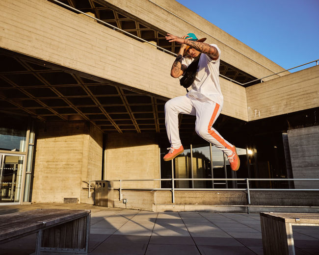 Model: Lance O'Doherty (Insta: @lance_ldn) Winning Architecture Arms Raised Balance Building Exterior Built Structure Day Full Length Human Arm Jumping Leisure Activity Lifestyles Low Angle View Mid-air Motion One Person Outdoors Real People Skill  Success Vitality Women Young Adult A New Beginning Redefining Menswear The Architect - 2019 EyeEm Awards
