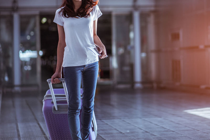 Adult Women Casual Clothing Airline Airport Arrival Bag Baggage Flight Holiday International Traveler Travel Transportation Transport Woman One Person Young Adult Indoors  Standing Walking Lifestyles Holding Architecture Day Focus On Foreground Young Women Flooring Corridor Arcade Beautiful Woman Hairstyle Jeans
