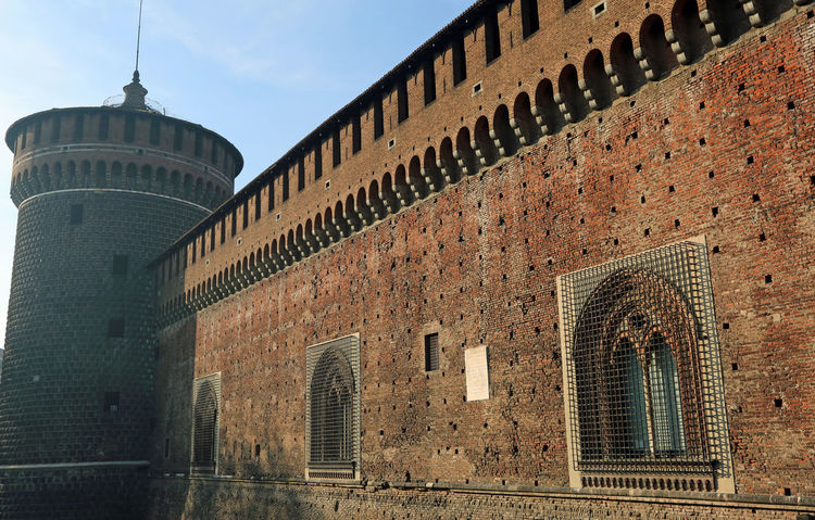 Italy, Milan, Big wall Castle called Castello Sforzesco Architecture Castle Castles Lombardy Milan Milano View Architecture Building Exterior Built Structure Castello Castello Sforzesco Castello Sforzesco Milano History Italian Italy Lombardia Medieval Milanese Old Outdoors Tower Travel Destinations Turret Window