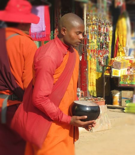 Color Orange Focus On Foreground Humilityinworship Monk  Monk And Tourist Monk Robes Praying Receiving Alms Reverance Robes Standing Monk Temple