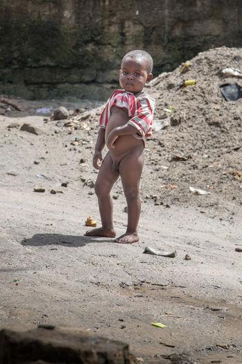 Portrait of boy standing on land