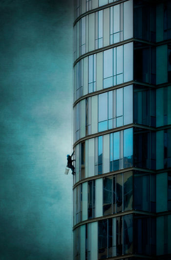 Window Washer. Architecture Artistic Building Exterior Built Structure City Cleaning Day High Rise Japan Low Angle View Modern Occupation Outdoors Real People Reflection RISK Rope Seattle Sky Skyscraper Text Textured  Window Window Washer Window Washer