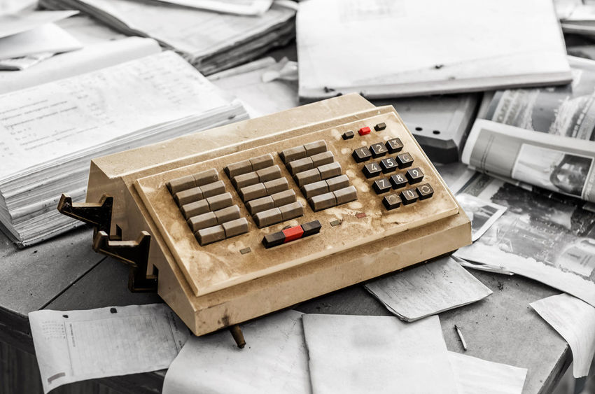 Old vintage junk telephone switch with buttons on the desk with documents Buttons Call Center Close-up Communication Dial Dirty Equipment Newspaper Old Paper Phone Retro Styled Still Life Table Technology Telephone Text