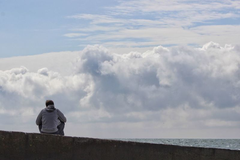 Thinking of future Sky Rear View Cloud - Sky Real People Nature Lifestyles Men One Person Leisure Activity Beauty In Nature Full Length Standing Outdoors Scenics Day Sea Water Looking Ahead Looking Away Sitting Man At The Beach Looking At Sky Lines Horizon Over Water The Great Outdoors - 2017 EyeEm Awards Breathing Space Go Higher