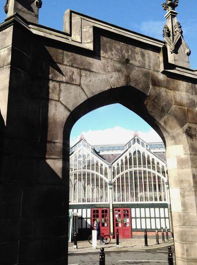 Taking Photos View of market hall through stone gate