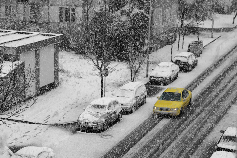 Architecture Car Cold Temperature Day Land Vehicle Mode Of Transport Nature No People Outdoors Snow Snowing Transportation Tree Winter Yellow Taxi Black Motion Wintertime Rainy Season Weather Bare Tree Road Apartment Building Terrace Built Structure