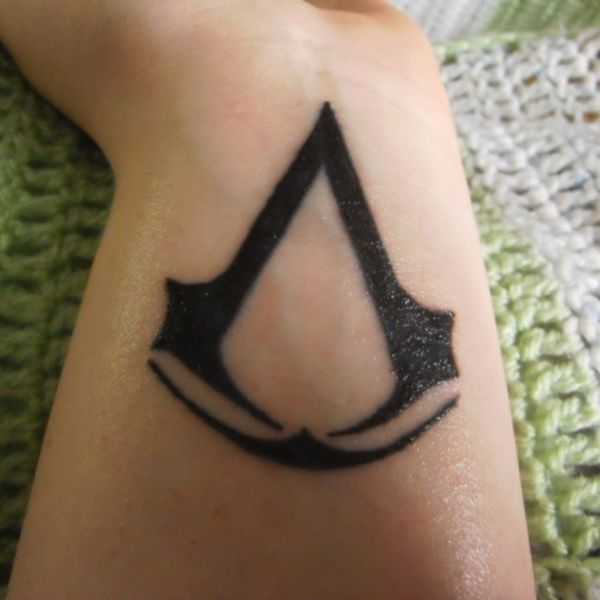 ALL I WANT IS THIS TATTOO Assassinscreed Tattoo Favorite PCgame TattooLove Logo Instatattoo Gamerworld Love