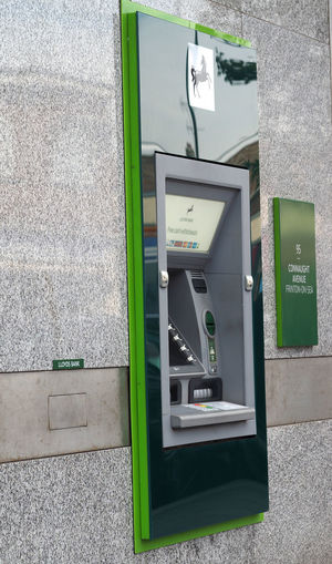 Architecture Atm Machines Built Structure Close-up Communication Day Fuel Pump Lloyds Bank No People Outdoors Pay Phone Technology Text