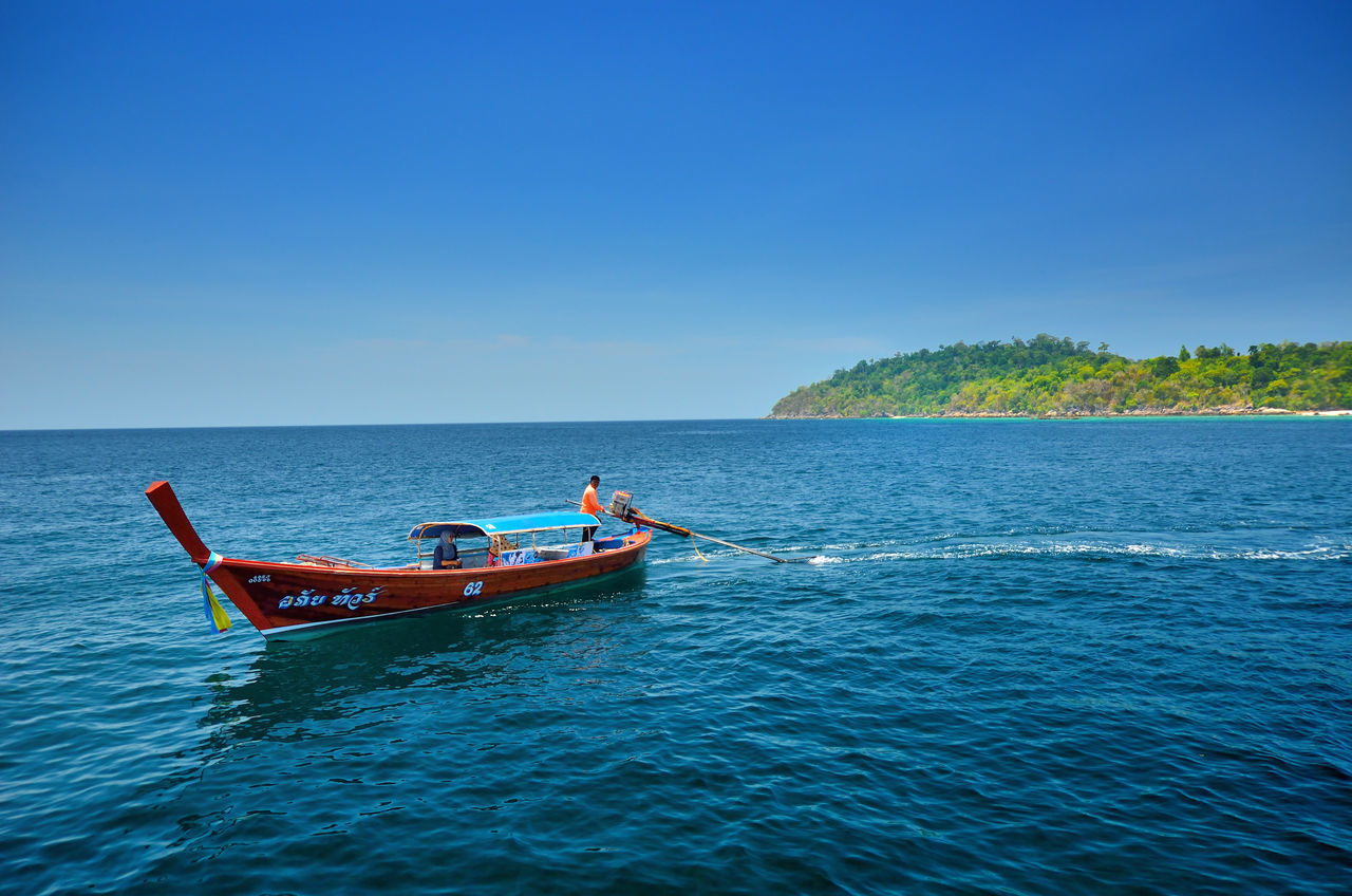 nautical vessel, water, sea, transportation, mode of transport, copy space, nature, blue, clear sky, waterfront, beauty in nature, scenics, outdoors, day, horizon over water, sky, sailing, no people, jet boat