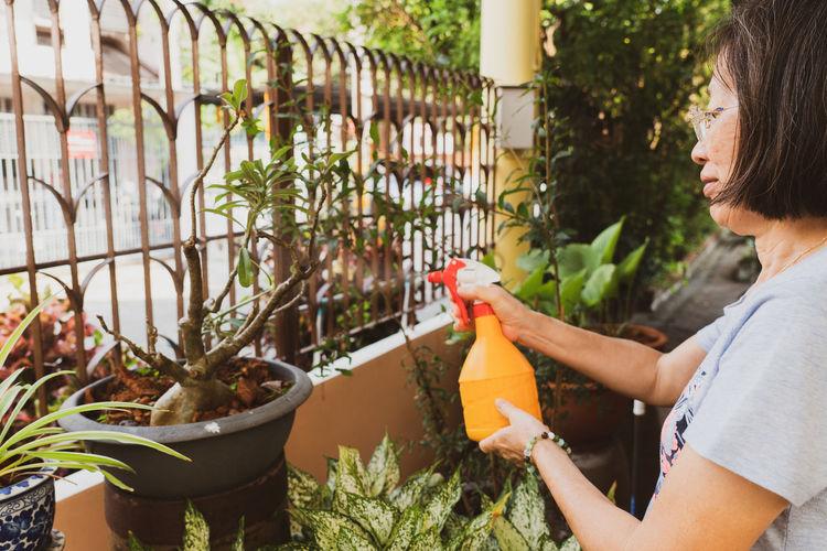 Woman holding plants