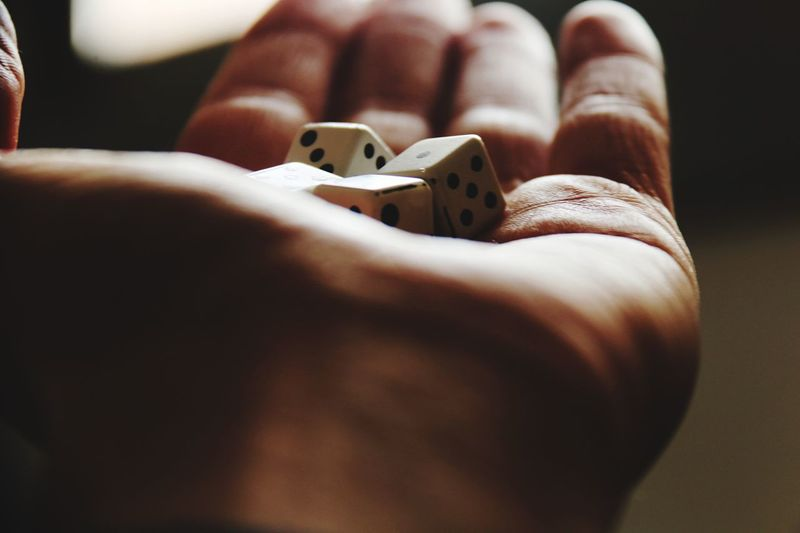 Game Dice Dice Game Dices Hand Luck EyeEm Selects Indoors  Close-up Real People Human Body Part Human Hand One Person Day People EyeEmNewHere This Is Masculinity