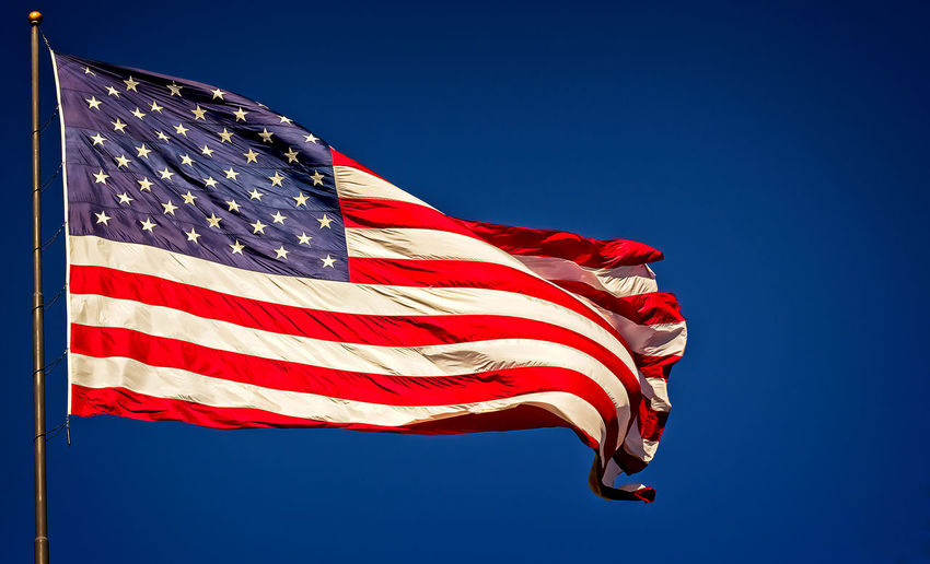 United States Flag Patriotism Flag Sky Striped Clear Sky Low Angle View Wind Nature Blue Red Day Star Shape No People Sunlight Pride Freedom Waving Independence Outdoors US Flag United States Flag