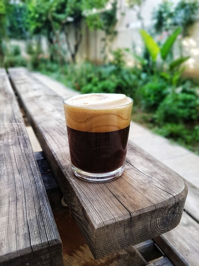 Ice coffee time for summer Summer Drink Garden Wooden Table Frothy Drink Drink Drinking Glass Latte Wood - Material Table Coffee - Drink Cold Temperature Close-up Iced Coffee Caffeine Cappuccino Espresso Coffee Foam Black Coffee