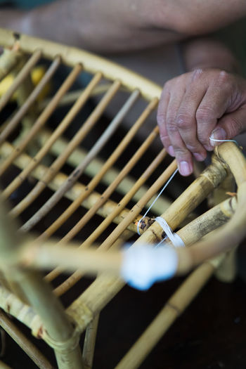 Close-up of man making wooden chair