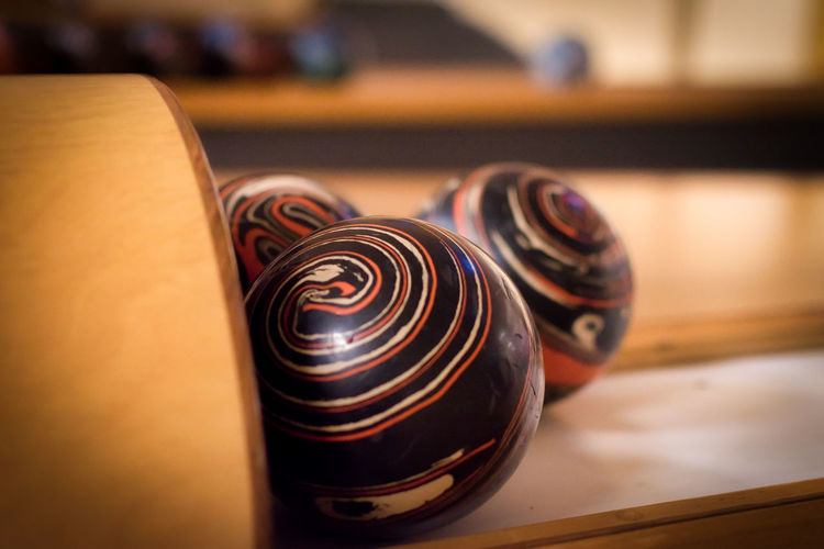 A day at the bowling alley. Antique Art And Craft Arts Culture And Entertainment Ball Bowling Bowling Alley Bowling Balls Close-up Craft Creativity Domestic Room Focus On Foreground Group Of Objects Indoors  No People Pattern Relaxation Selective Focus Spiral Still Life Table Wood - Material