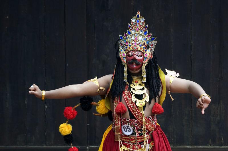 Traditional dancer dancing on street