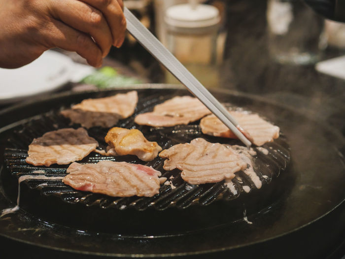 Chopsticks Human Hand Smoke Pan Hot Stove Black Vintage Style Retro Restaurant Japan Pork SLICE Beef Meal Meat! Meat! Meat! Human Hand Dumpling  City Chopsticks Japanese Food Close-up Dim Sum Serving Tongs Barbecue Grill Chinese Takeout Asian Food Chinese Food Barbecue Steamed