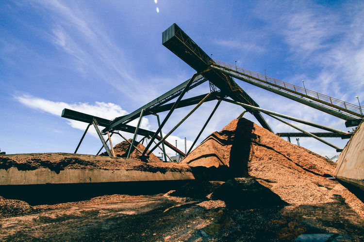 Low Angle View Of Metallic Structure At Industry Against Sky