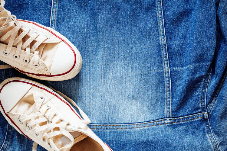 Close-Up Of Shoes On Denim Shirt