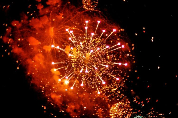 Perfect Celebration Motion Firework Display Night Glowing Exploding Arts Culture And Entertainment Low Angle View Firework - Man Made Object Sparks Sky Vibrant Color Red Bright Russia Perfect Circle Event Entertainment Outdoors Illuminated
