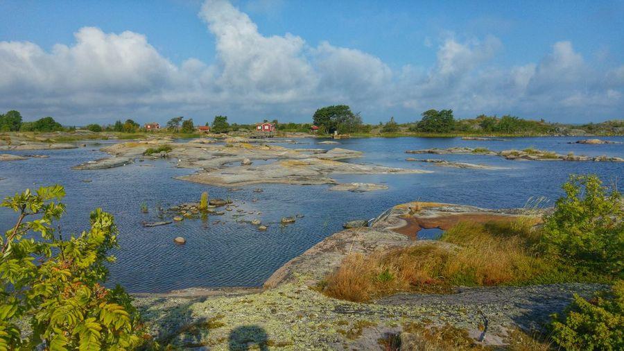 Archipelago In Lake Against Cloudy Sky