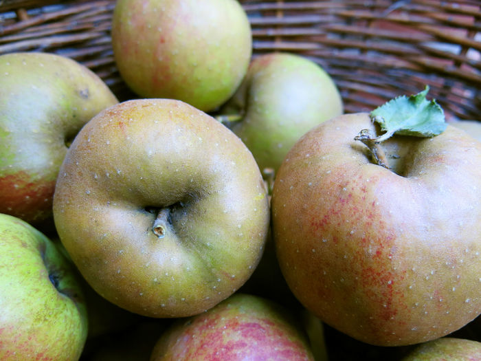 Close-Up Of Apples In Basket At Market Stall