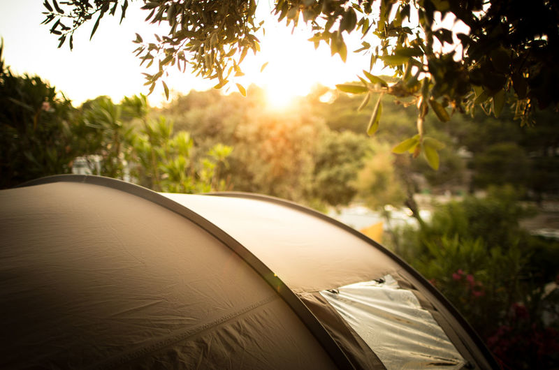 Close-up of tent against sky during sunset
