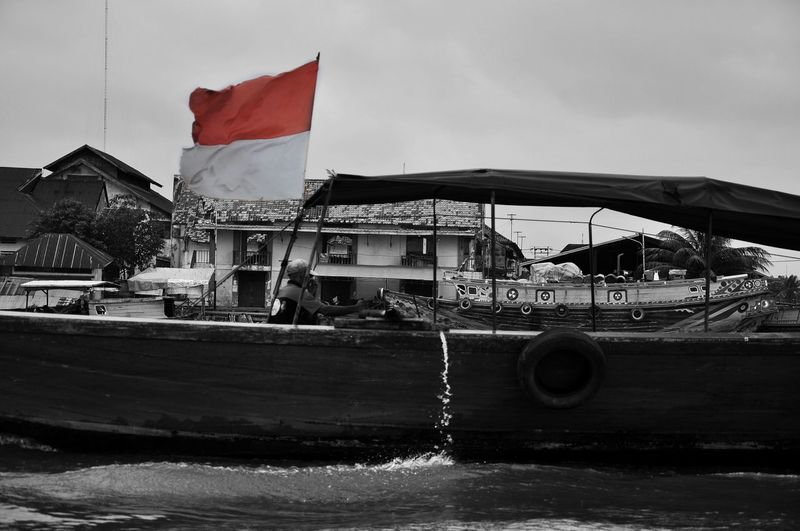 indonesia Blackandwhite Bw INDONESIA Politics And Government City Patriotism Flag Sky Insignia Riot Nautical Vessel River Moored Shield Sailing Outrigger Longtail Boat Wake - Water Motorboat Sailboat Logo Protest Sailing Ship Marina Yacht Ferry Water Vehicle Protestor Houseboat Tall Ship