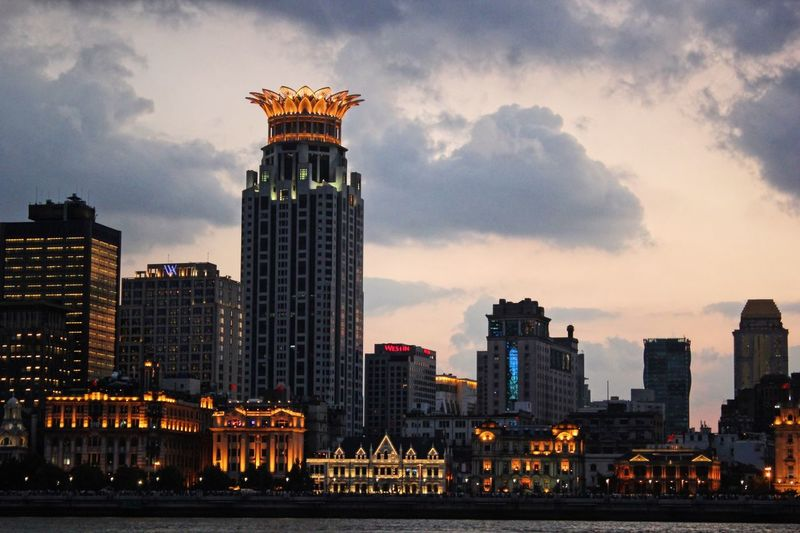 Architecture Built Structure Building Exterior Skyscraper Sky City Tower Cloud - Sky Cityscape Travel Destinations Outdoors Modern Urban Skyline Day No People Illuminated Sunset