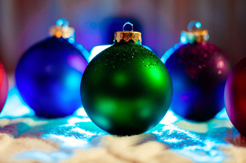 Close-up of colorful christmas ornaments on table