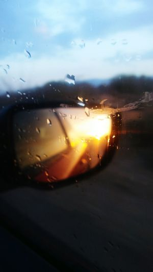 Close-up of raindrops on car window