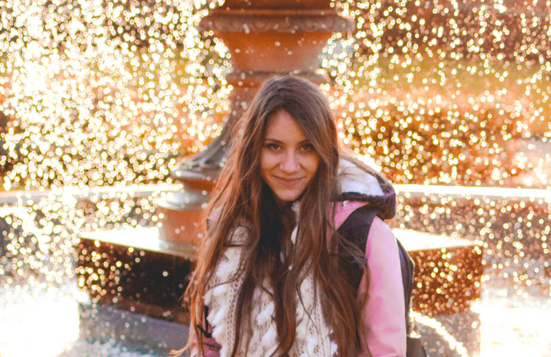 The Portraitist - 2018 EyeEm Awards Adult Beautiful Woman Beauty Brown Hair Emotion Front View Hair Hairstyle Happiness Long Hair Looking At Camera One Person Outdoors Portrait Real People Scarf Smiling Standing Warm Clothing Women Young Adult