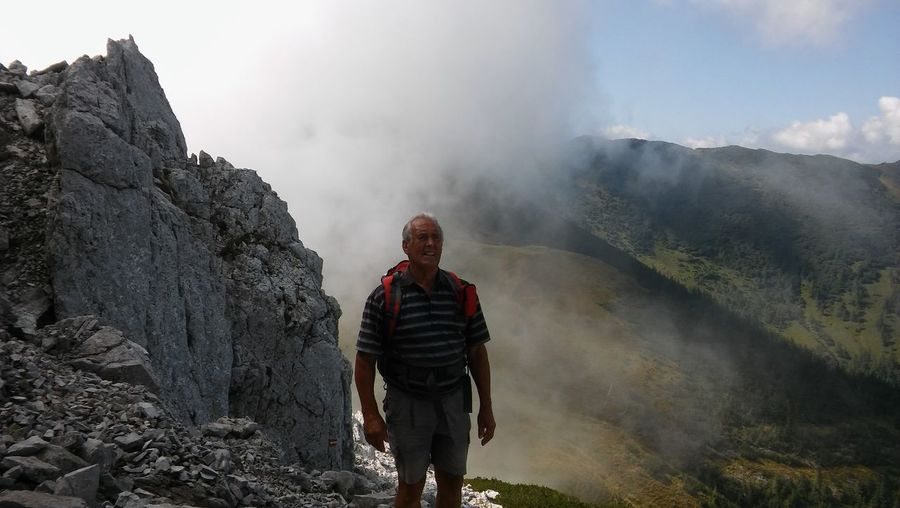 Hiker standing on mountain