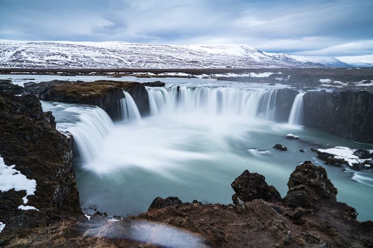 Up on high. Waterfall Nature Beauty In Nature Environment Scenics Water Winter Cold Temperature Ice Motion Outdoors Landscape Snow Mountain Iceland Trip Iceland Iceland_collection Iceland Memories Goðafoss Godafoss Flowing Water Waterfalls Slow Shutter Long Exposure Nature