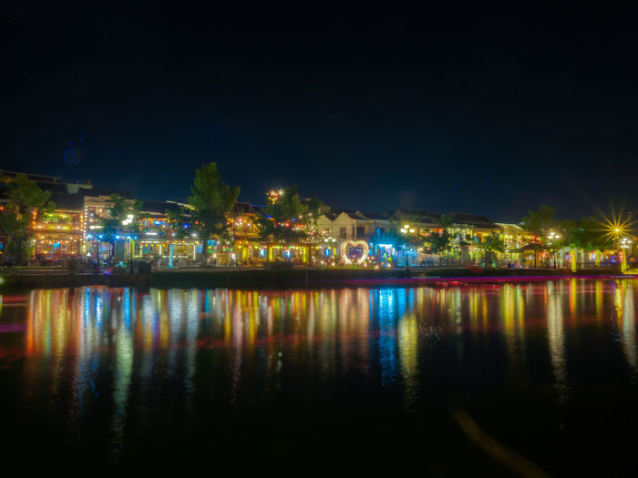 Night Reflection Illuminated Water Architecture Waterfront City Building Exterior No People Sky Built Structure Nature River Building Copy Space Multi Colored Outdoors Light Dark Nightlife