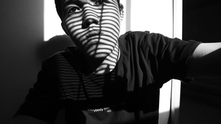 Portrait Of Man With Shadow At Home