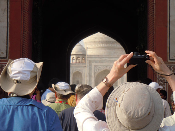 Group of people clicking photo of taj mahal