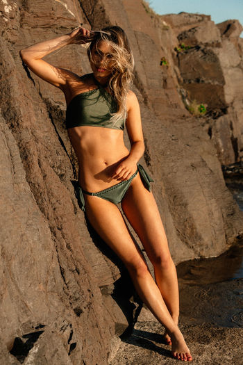 Rock Rock - Object One Person Solid Young Adult Leisure Activity Lifestyles Clothing Women Full Length Young Women Real People Adult Bikini Swimwear Rock Formation Hair Outdoors Hairstyle Beautiful Woman