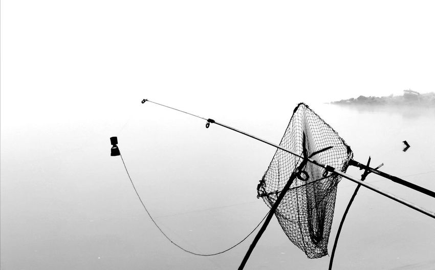 Low angle view of fishing net against clear sky