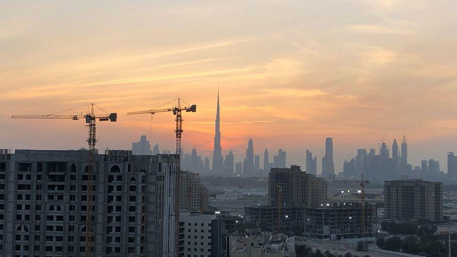 Crane - Construction Machinery Burj Khalifa Dubai EyeEm Selects Architecture Built Structure Sky Sunset City Building Building Exterior Skyscraper Tall - High Cityscape Cloud - Sky No People Tower Landscape Urban Skyline Modern Outdoors