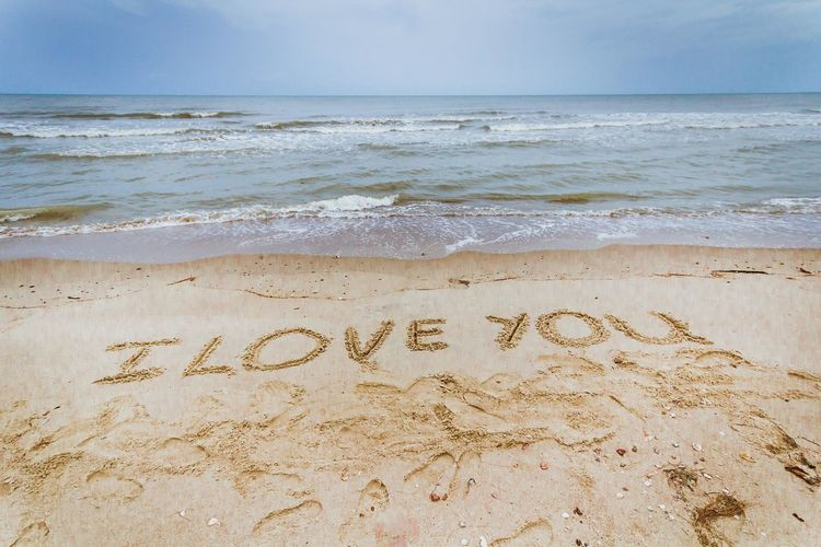 High Angle View Of I Love You Message On Sandy Beach